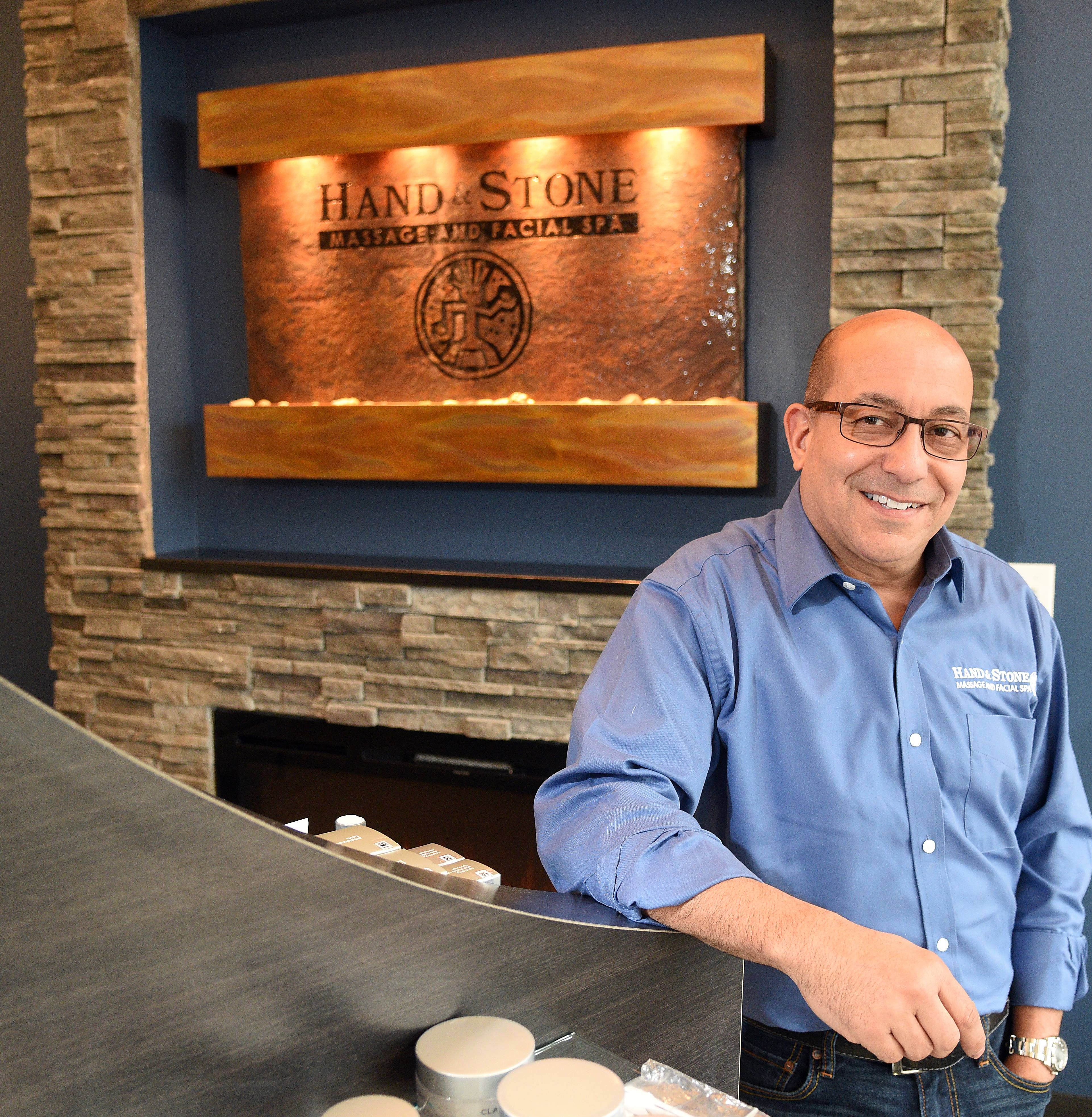 Bill Christy of St. Charles went from busy, globe-trotting CEO to owning three locations of Hand & Stone Massage and Facial Spa, including this one that opened Monday in South Elgin.