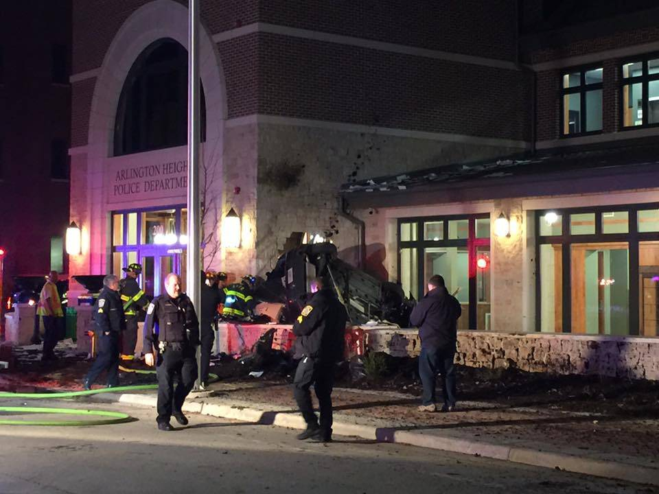 Arlington Heights police and firefighters were on the scene Sunday night after a car flipped over and crashed into the new police station in the village's downtown.