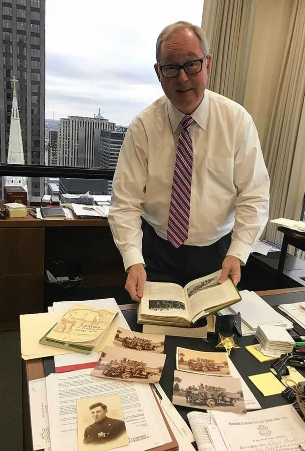 The office desk on the 28th floor of Chicago's Daley Center tells the story of Cook County circuit court Judge John J. Curry Jr.'s immigrant grandfather. The Barrington judge says William Burke was naturalized against his wishes but became an American during World War I.