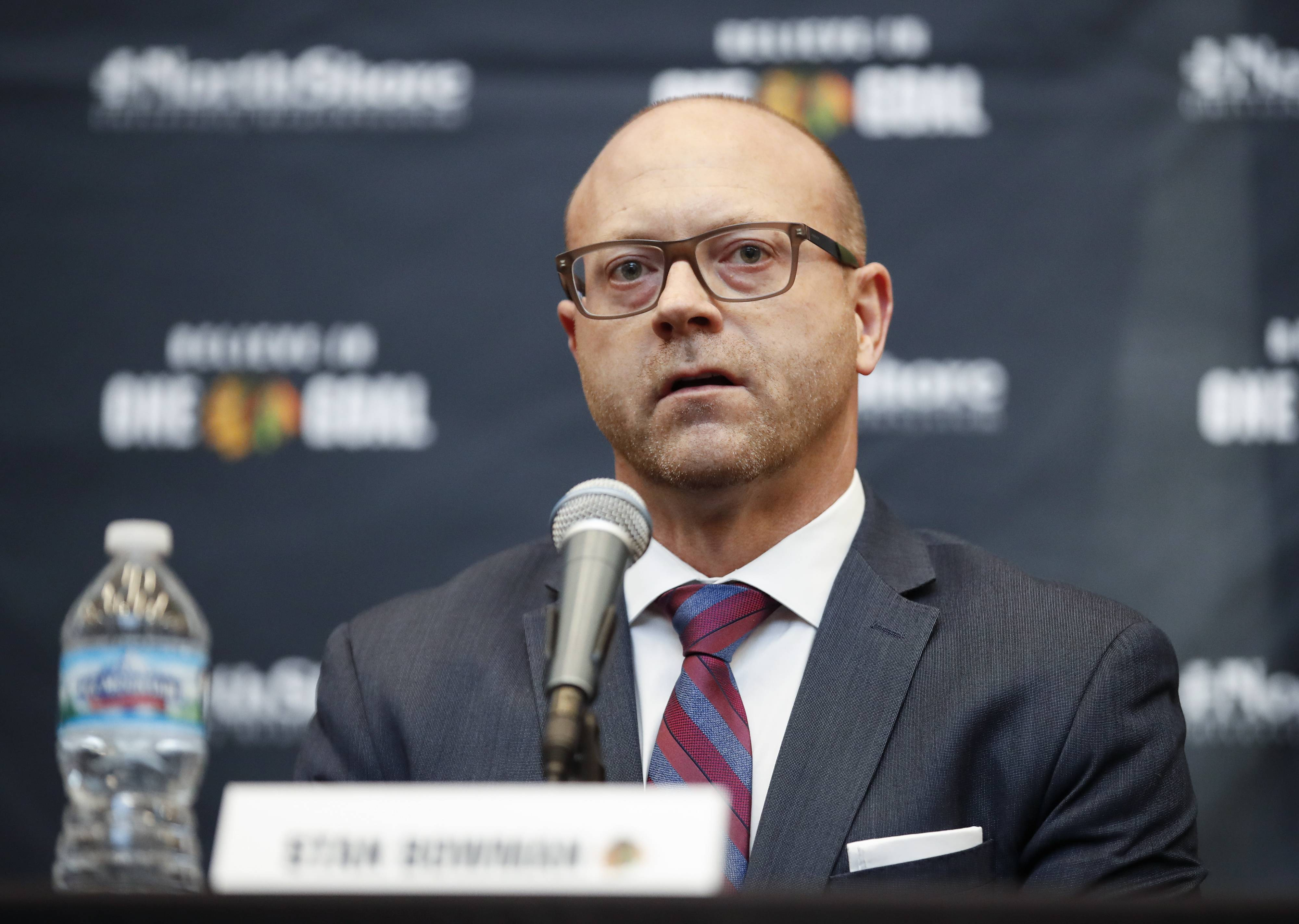 Blackhawks Senior Vice President and General Manager Stan Bowman speaks with reporters last week after Joel Quenneville was fired and Jeremy Colliton was named coach.