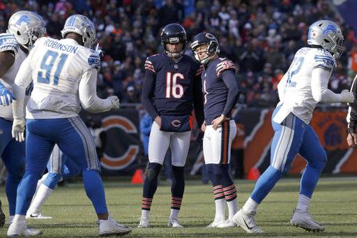 Chicago Bears kicker Cody Parkey (1) reacts as he talks to holder Pat O'Donnell (16) after missing a field goal during the second half of an NFL football game against the Detroit Lions Sunday, Nov. 11, 2018, in Chicago. (AP Photo/David Banks)