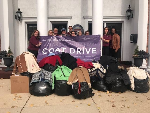 The Glen Ellyn, Naperville, Elmhurst, Hinsdale and Wheaton offices of Berkshire Hathaway HomeServices KoenigRubloff Realty Group collect 500 winter coats for DuPage PADS.