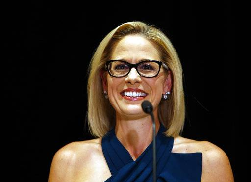 U.S. Sen.-elect Kyrsten Sinema, D-Ariz., smiles after her victory over Republican challenger U.S. Rep. Martha McSally, Monday, Nov. 12, 2018, in Scottsdale, Ariz. Sinema won Arizona's open U.S. Senate seat in a race that was among the most closely watched in the nation, beating McSally in the battle to replace GOP Sen. Jeff Flake. (AP Photo/Rick Scuteri)