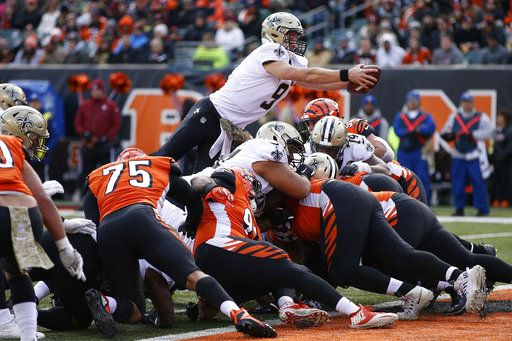 New Orleans Saints quarterback Drew Brees (9) dives in for a touchdown in the second half of an NFL football game, Sunday, Nov. 11, 2018, in Cincinnati.