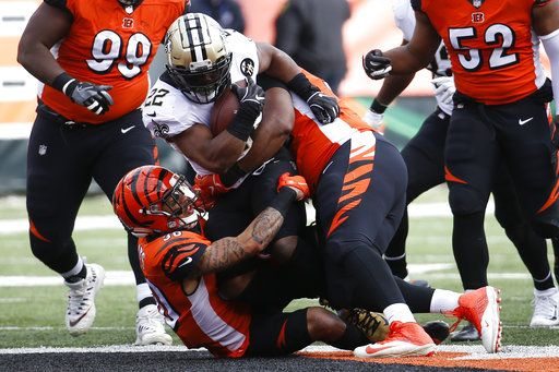 New Orleans Saints running back Mark Ingram (22) is tackled on the run by Cincinnati Bengals free safety Jessie Bates (30) in the first half of an NFL football game, Sunday, Nov. 11, 2018, in Cincinnati.