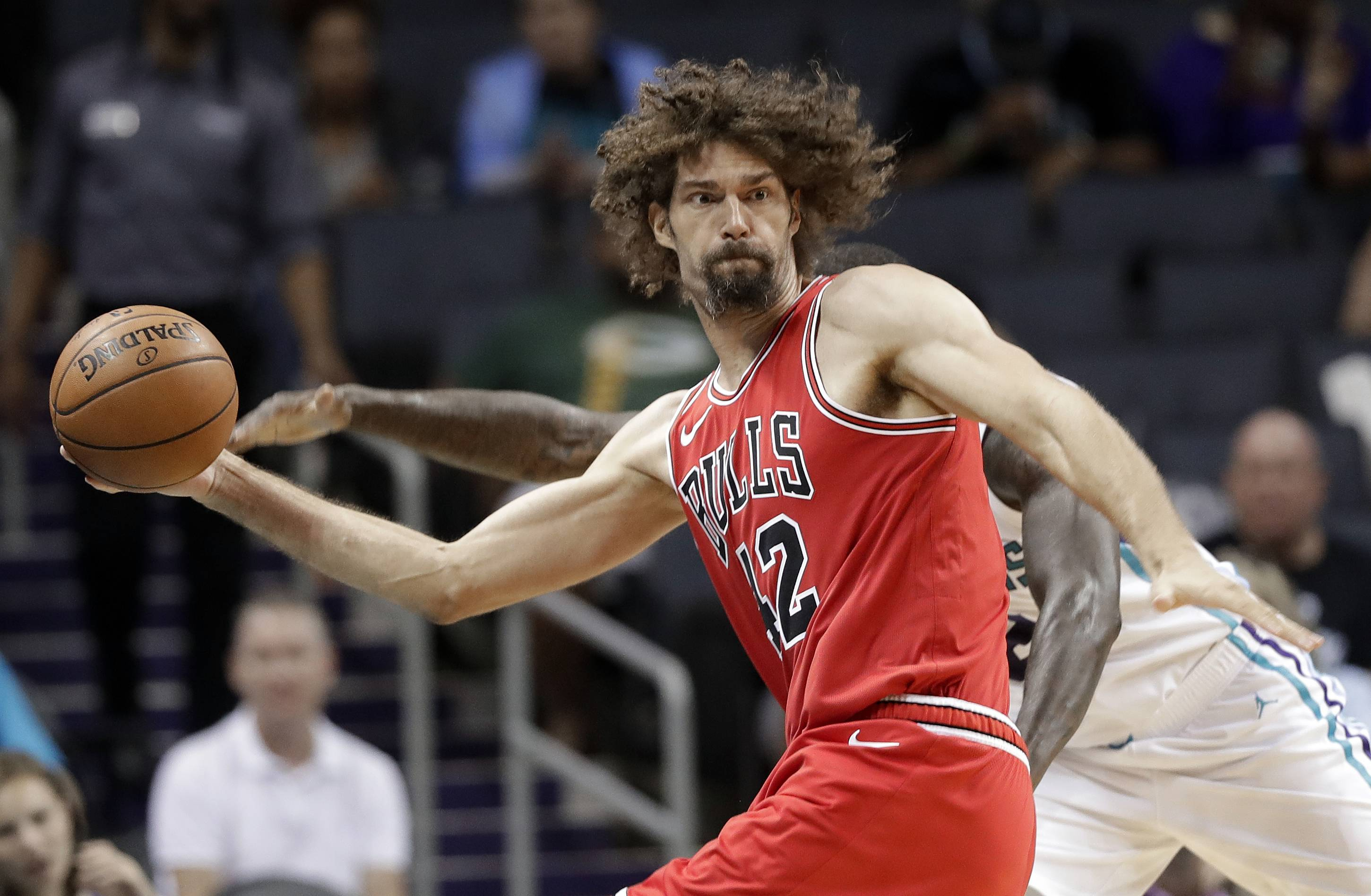 Chicago Bulls' Robin Lopez (42) looks to pass the ball against the Charlotte Hornets in the second half of a preseason NBA basketball game in Charlotte, N.C., Monday, Oct. 8, 2018. (AP Photo/Chuck Burton)