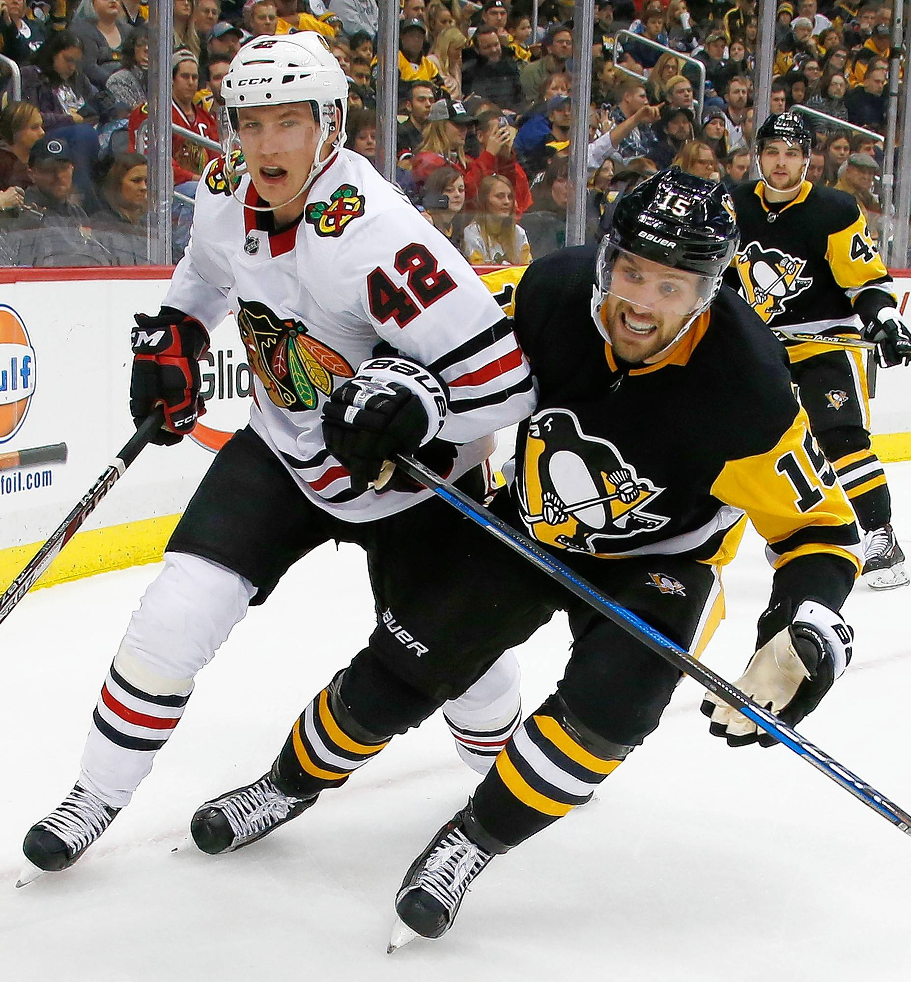 Pittsburgh Penguins' Riley Sheahan (15) and Blackhawks' defenseman Gustav Forsling (42) work in the corner during a 2017 game. The Blackhawks' decision to call Gustav Forsling up from Rockford means the team will be carrying eight defensemen. It's not a common strategy among NHL teams, but coach Jeremy Colliton believes the competition could benefit his squad in the long run.