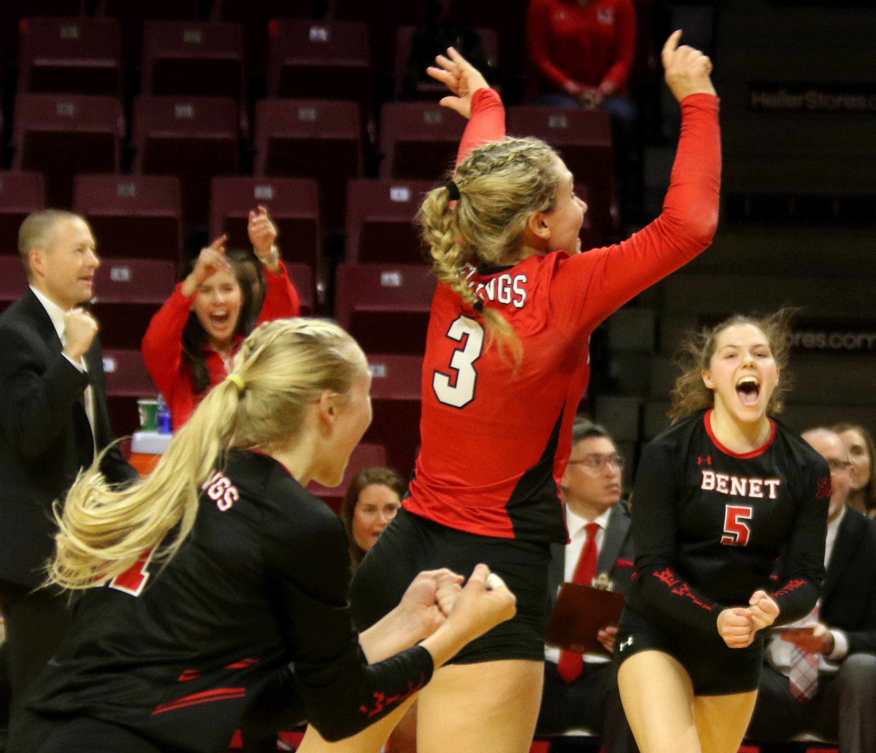 Benet Academy's Redwings celebrate a two-set victory over Prairie Ridge in the third-place game of the Class 4A state finals in girls volleyball on Saturday night at Redbird Arena on the campus of Illinois State University. At center is Hattie Monson and at right is Caroline Gard.