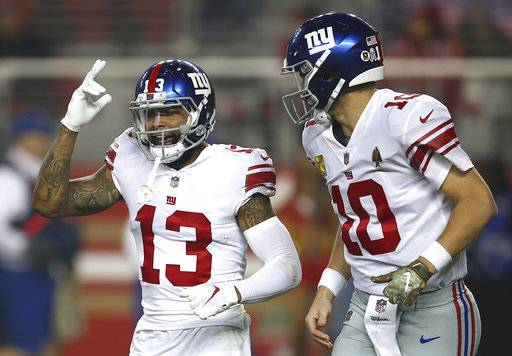 New York Giants wide receiver Odell Beckham Jr. (13) and quarterback Eli Manning (10) celebrate after connecting on a touchdown pass against the San Francisco 49ers during the second half of an NFL football game in Santa Clara, Calif., Monday, Nov. 12, 2018. (AP Photo/Ben Margot)