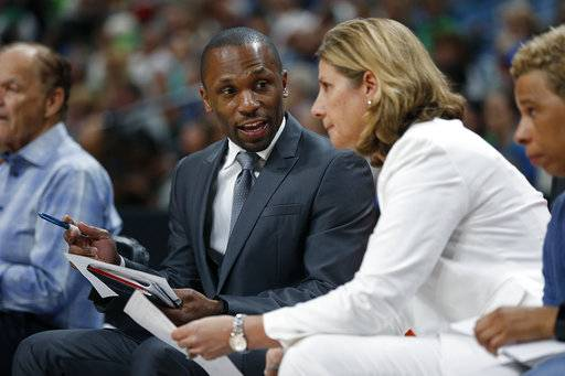 Minnesota Lynx WNBA basketball head coach Cheryl Reeve listens to assistant coach James Wade on the bench during a game against the Los Angeles Sparks, Thursday, July 6, 2017, in St. Paul, Minn. Minnesota Lynx assistant James Wade has been hired to coach the Chicago Sky, Tuesday, Nov. 13, 2018. (Elizabeth Flores/Star Tribune via AP)