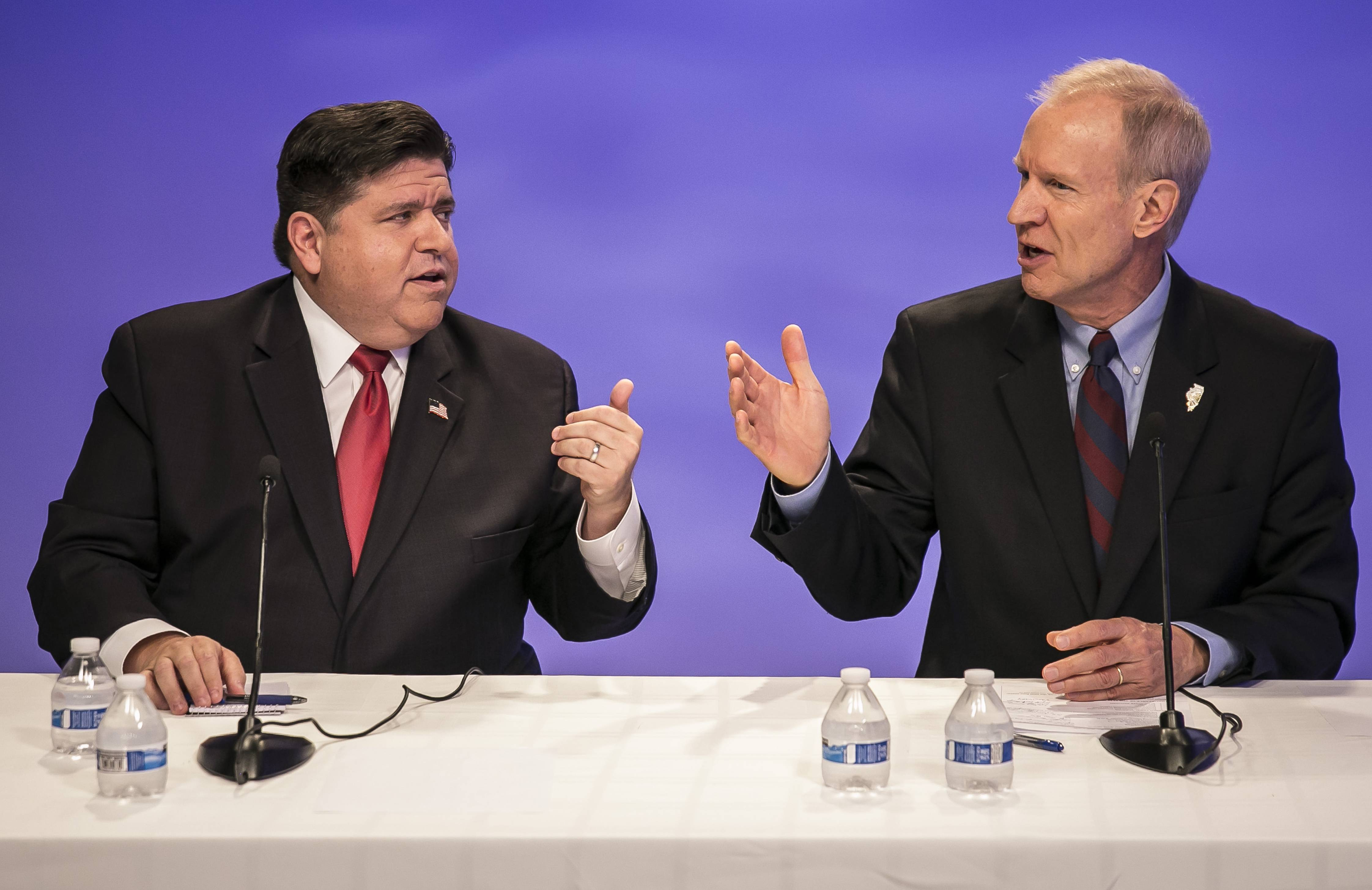 Democrat J.B. Pritzker, left, and Republican Bruce Rauner raised a combined $255 million, most of it from themselves, in their campaigns for Illinois governor.