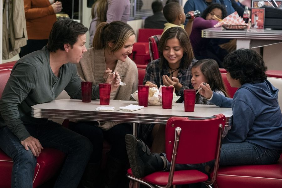 "Pete and Ellie (Mark Wahlberg and Rose Byrne) give foster parenthood a try with three siblings (Isabela Moner, Julianna Gamiz and Gustavo Quiroz) in ""Instant Family."""
