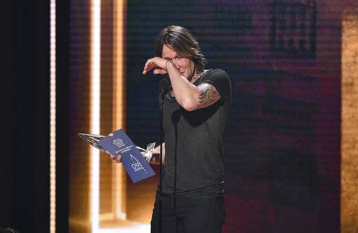 Keith Urban wipes away tears as he accepts the award for entertainer of the year at the 52nd annual CMA Awards at Bridgestone Arena on Wednesday, Nov. 14, 2018, in Nashville, Tenn. (Photo by Charles Sykes/Invision/AP)
