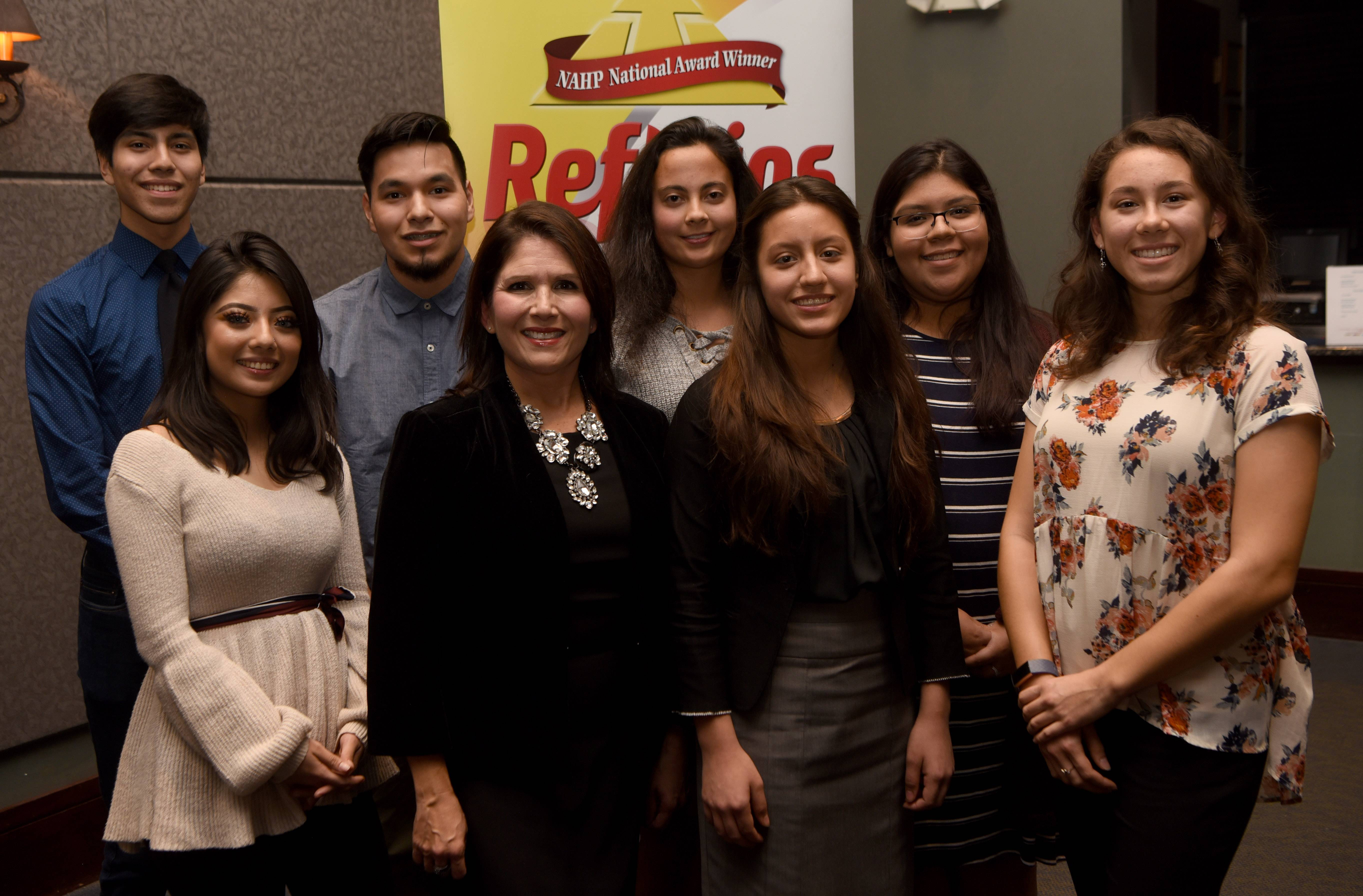 Scholarship recipients stand with Lt. Gov. Evelyn Sanguinetti, second from left in front row, during the Reflejos awards event Wednesday at Stonegate Banquets in Hoffman Estates.