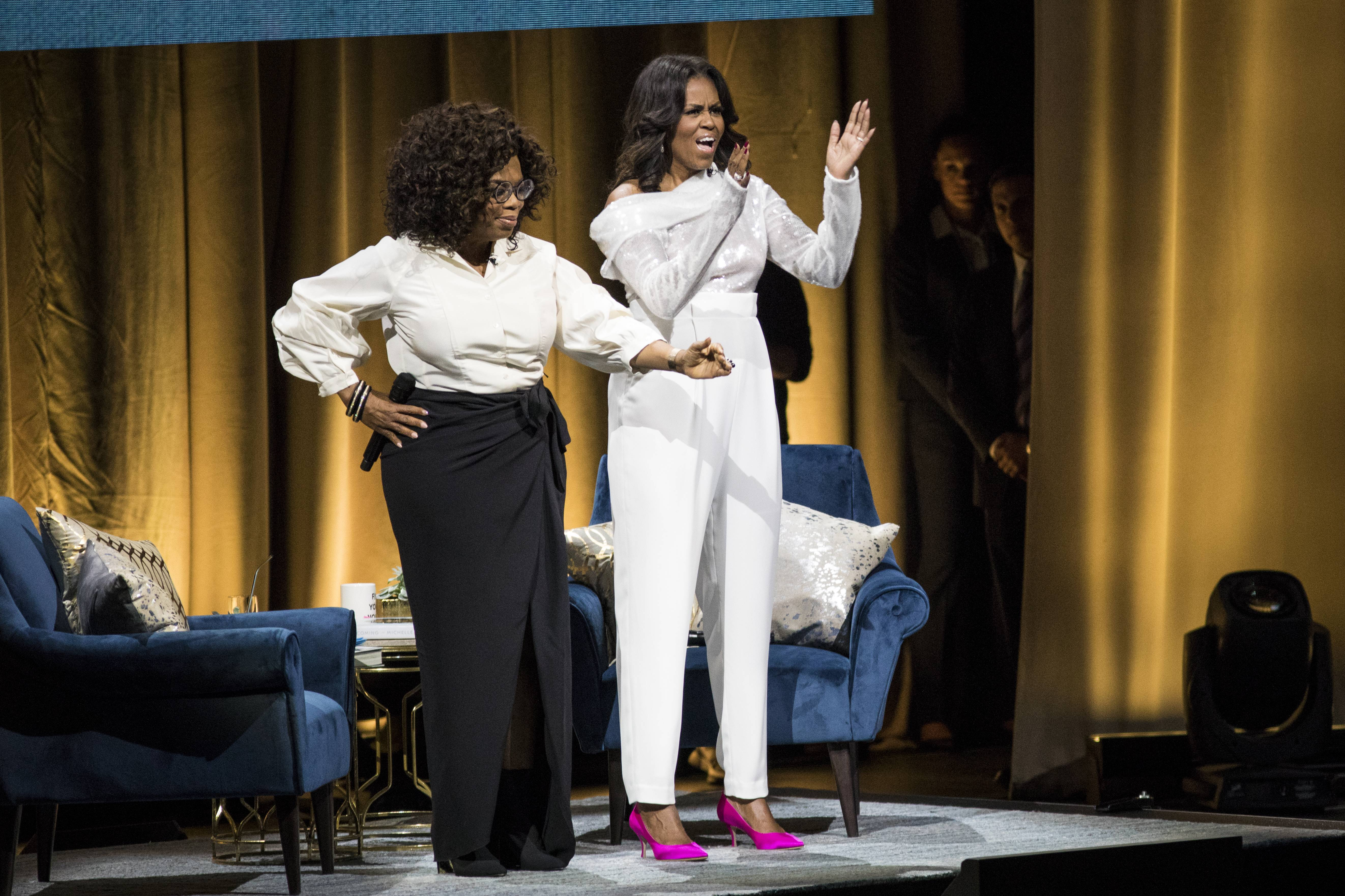 "Oprah Winfrey introduces former first lady Michelle Obama on Tuesday night during the kickoff event for Obama's new book, ""Becoming,"" at the United Center."