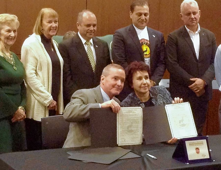 Elk Grove Village Mayor Craig Johnson, seated from left, and Pernik, Bulgaria Mayor Vyara Tserovska signed a friendship agreement on behalf of their respective municipalities on Tuesday. They were joined by officials from both towns.