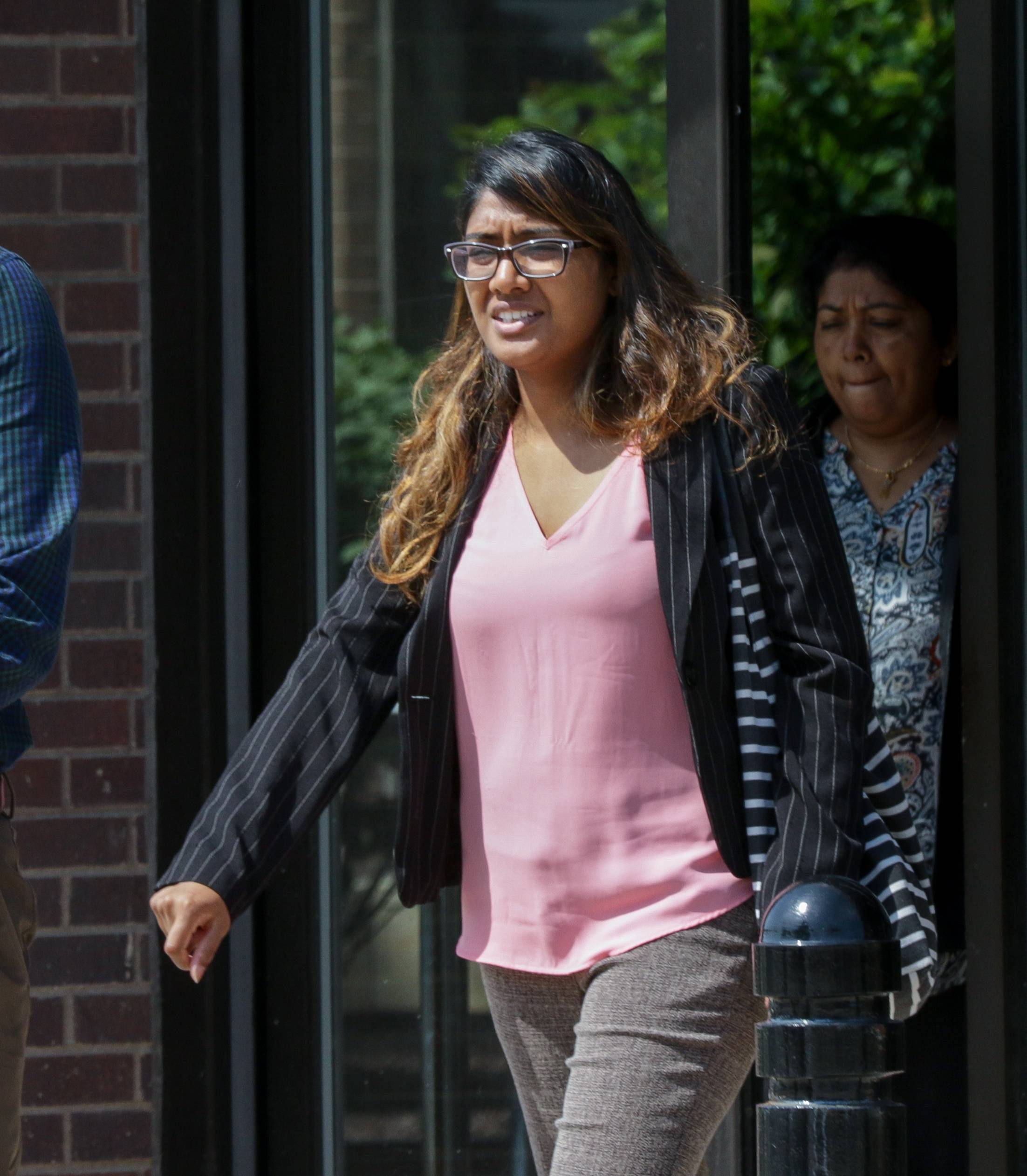Tina Jones walks out of the DuPage County courthouse in Wheaton, after pleading not guilty to solicitation of murder and attempted murder during her arraignment earlier this year.