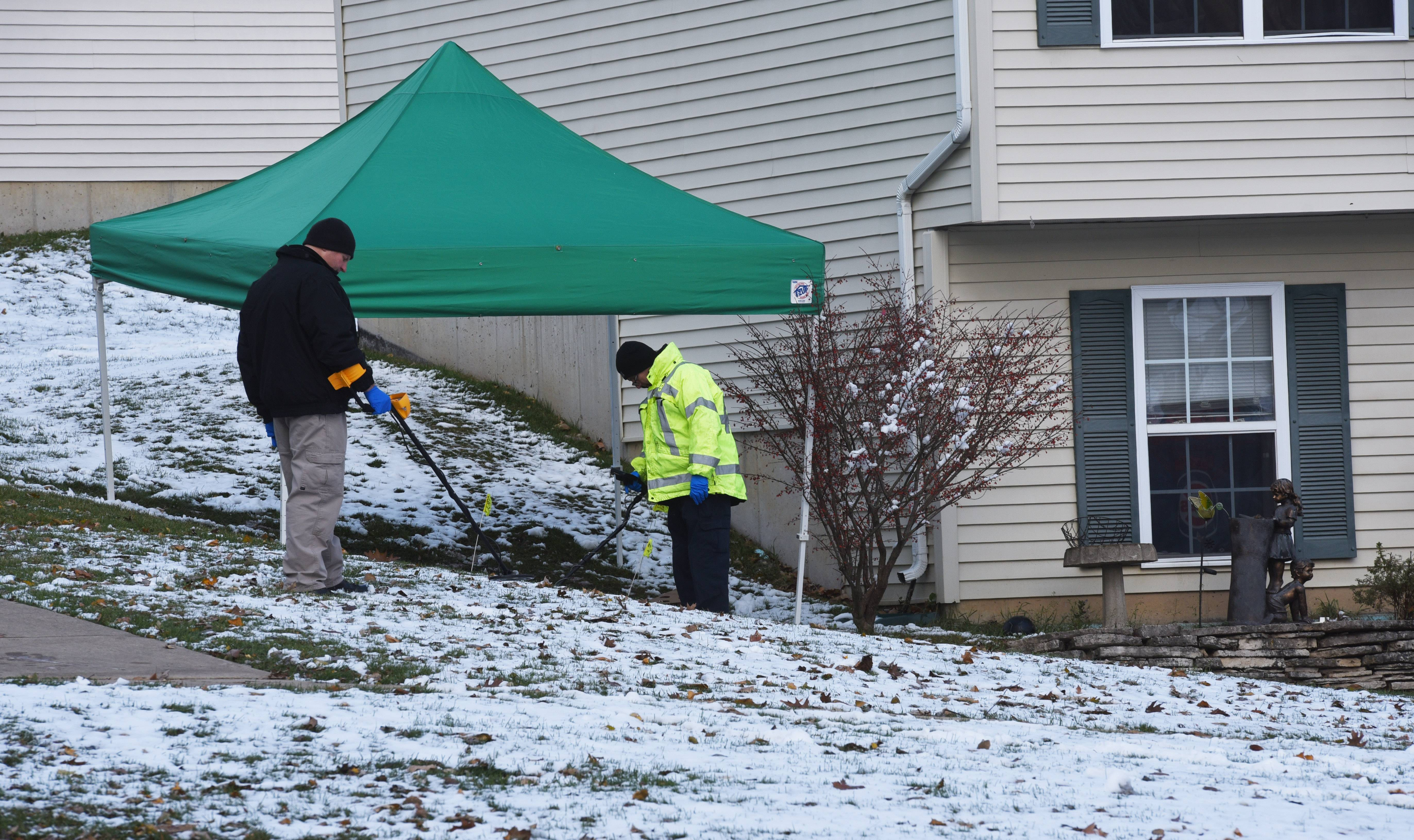 Police conduct an investigation at a home Friday on the 600 block of East Forest Avenue in West Chicago.