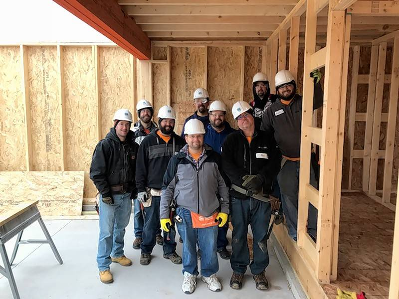 A group of MBX employees volunteered at Habitat for Humanity on Nov. 7, helping build houses.