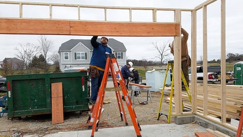 Employees of Libertyville-based MBX Systems help build a house with Habitat for Humanity.