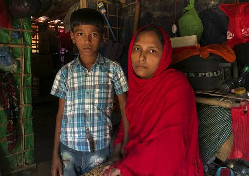 Rohingya refugees Sitara Begum with her son Mohammed Abbas, who are in the list for repatriation wait in their shelter at Jamtoli refugee camp, near Cox's Bazar, Bangladesh, Thursday, Nov. 15, 2018. Bangladesh authorities said Thursday that repatriation to Myanmar of some of the more than 700,000 Rohingya Muslims who fled army-led violence will begin as scheduled if people are willing to go, despite calls from United Nations officials and human rights groups for the refugees' safety in their homeland to be verified first. (AP Photo/Dar Yasin)