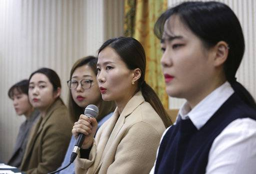 Kim Eun-jung, second from right, a member of South Korean Olympic women's curling team, speaks during a press conference in Seoul, South Korea, Thursday, Nov. 15, 2018. South Korea's hugely popular Olympic curlers have accused their coaches of ruining the team with abusive treatment in a dispute that has spoiled one of the year's feel-good sports stories.(AP Photo/Ahn Young-joon)