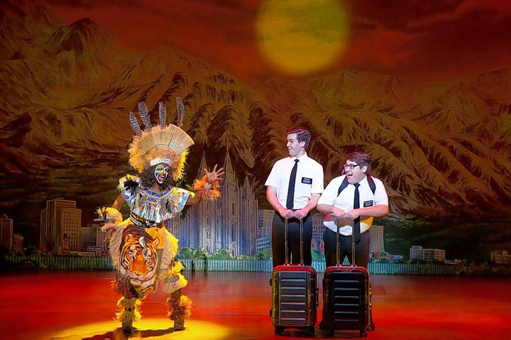 """The Book of Mormon"" returns to Chicago for a brief run. This November 2017 touring company photo shows Monica L. Patton, left, Kevin Clay and Connor Peirson."