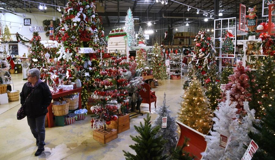 The owners of Treetime in Lake Barrington travel the world in the off season to oversee the design and assembly of its artificial trees.