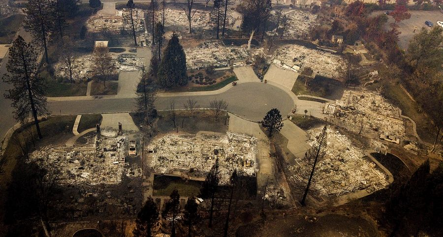 Residences leveled by the Camp Fire line a cul-de-sac in Paradise, California.