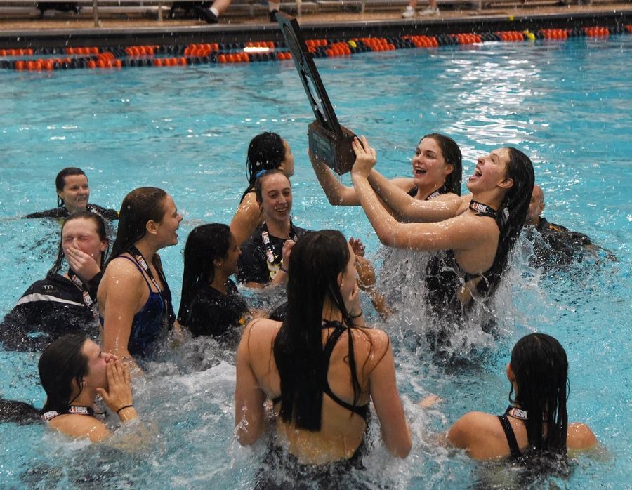Neuqua Valley celebrates its state championship at the conclusion of the girls state swimming finals at Evanston High School Saturday.