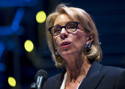 In this Sept. 17, 2018 photo, Education Secretary Betsy DeVos speaks during a student town hall at National Constitution Center in Philadelphia. DeVos is proposing a major overhaul to the way colleges handle complaints of sexual misconduct. The Education Department released a plan Friday that would require schools to investigate sexual assault and harassment only if it was reported to certain campus officials and only if it occurred on campus or other areas overseen by the school.