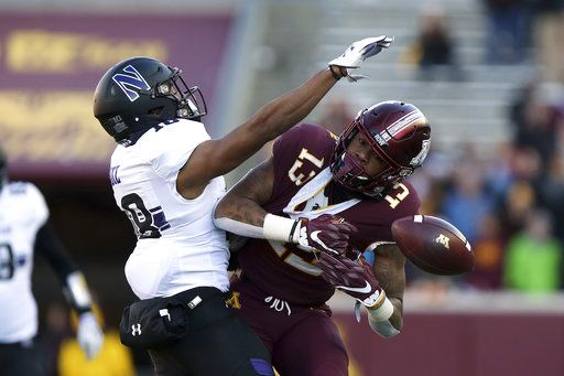 Minnesota wide receiver Rashod Bateman misses a catch against the defense of Northwestern's Cameron Ruiz during an NCAA college football game Saturday, Nov. 17, 2018, in Minneapolis. Northwestern won 24-14.