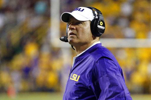 FILE - This Sept. 17, 2016 file photo shows LSU head coach Les Miles watching from the sideline in the second half of an NCAA college football game against Mississippi State in Baton Rouge, La. Miles is in negotiations with Kansas to take over the down-trodden Jayhawks, a person with knowledge of the discussions told The Associated Press. Sports Illustrated was the first to report that Miles and Kansas athletic director Jeff Long were discussing a contract. It remains unclear when a deal will be complete. (AP Photo/Gerald Herbert, File)