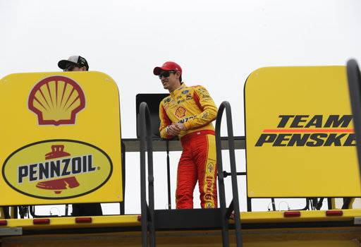 Joey Logano watches from his hauler during practice for the NASCAR Cup series auto race at the Homestead-Miami Speedway, Friday, Nov. 16, 2018, in Homestead, Fla. (AP Photo/Lynne Sladky)