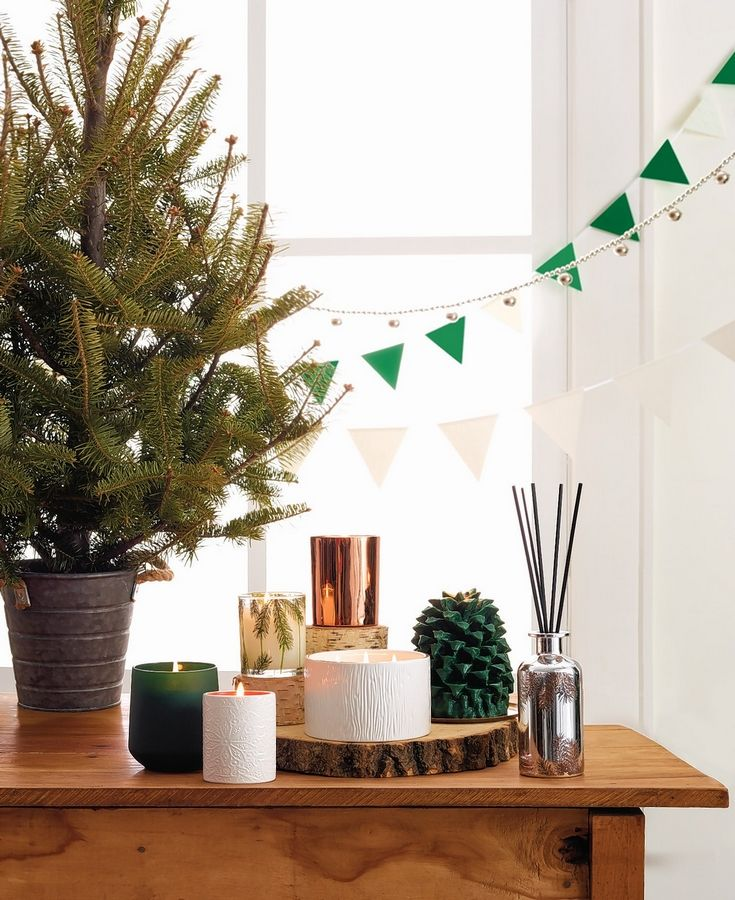 In addition to looking beautiful, these assorted Thymes Frasier Fir Candles fill your home with a crisp, just-cut forest fragrance that is a staple for any holiday celebration.