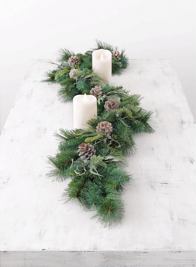 Bodega Bay decorated garland featuring soft green foliage, berries and whitewashed pine cones.