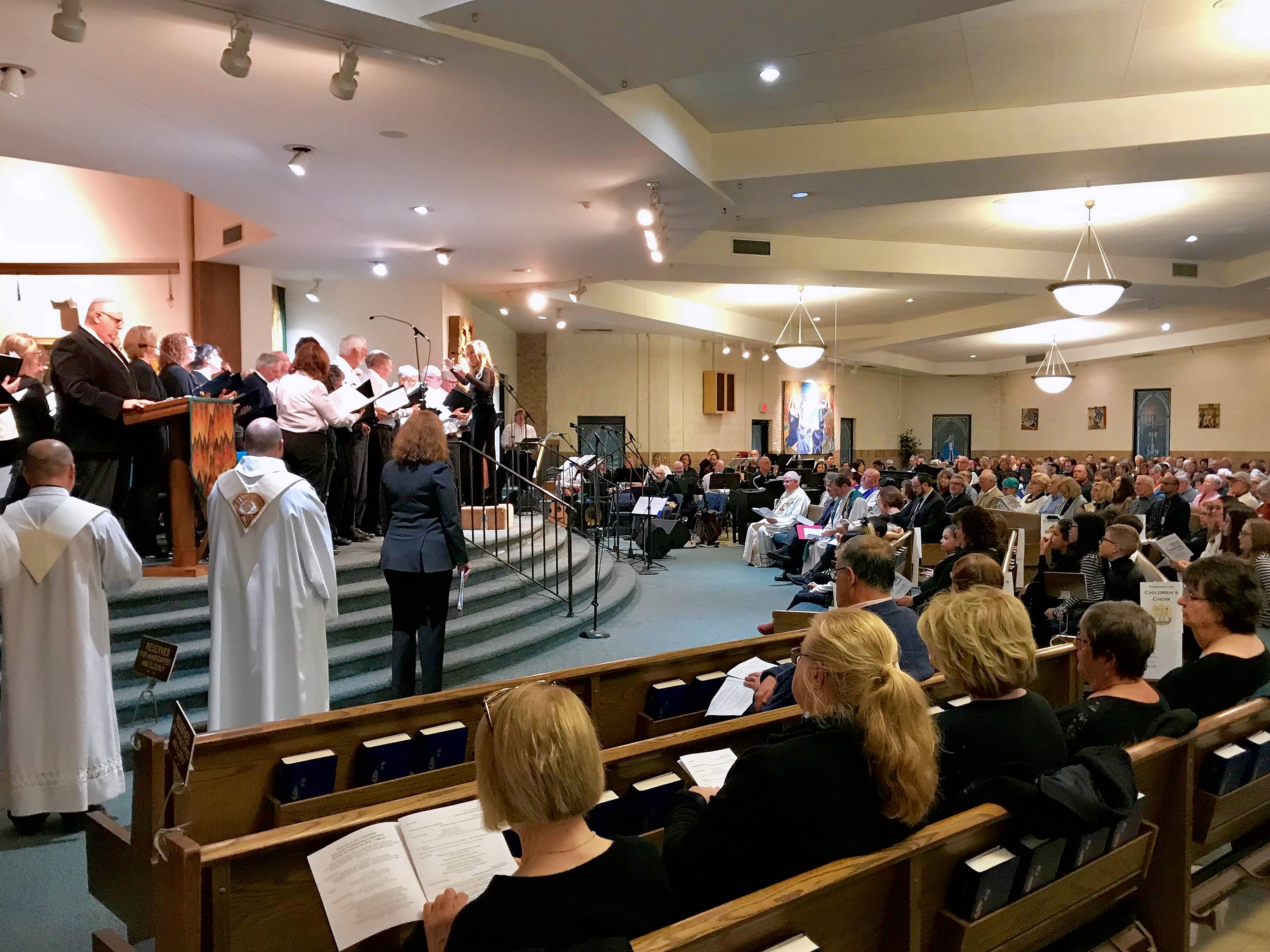 Religious leaders and a combined congregational choir sings about peace and unity Sunday night during an interfaith Thanksgiving celebration in Buffalo Grove that drew nearly 1,000 people.