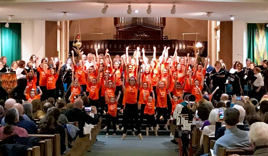 A dance group performs in front of nearly 1,000 people who attended an interfaith Thanksgiving celebration Sunday at St. Mary Parish in Buffalo Grove.