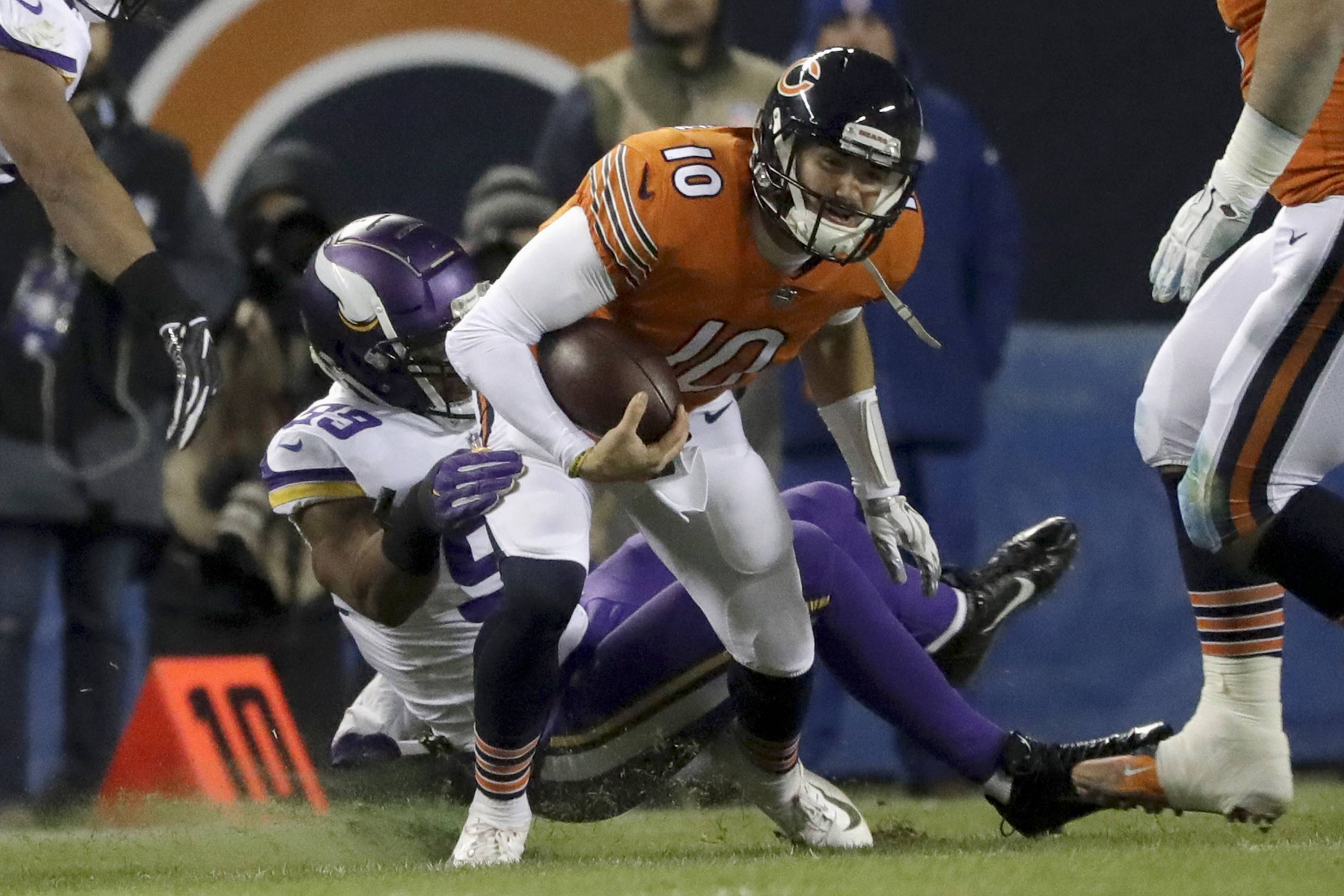 Minnesota Vikings defensive end Danielle Hunter tackles Chicago Bears quarterback Mitchell Trubisky (10) during the first half of an NFL football game Sunday, Nov. 18, 2018, in Chicago. (AP Photo/Nam Y. Huh)