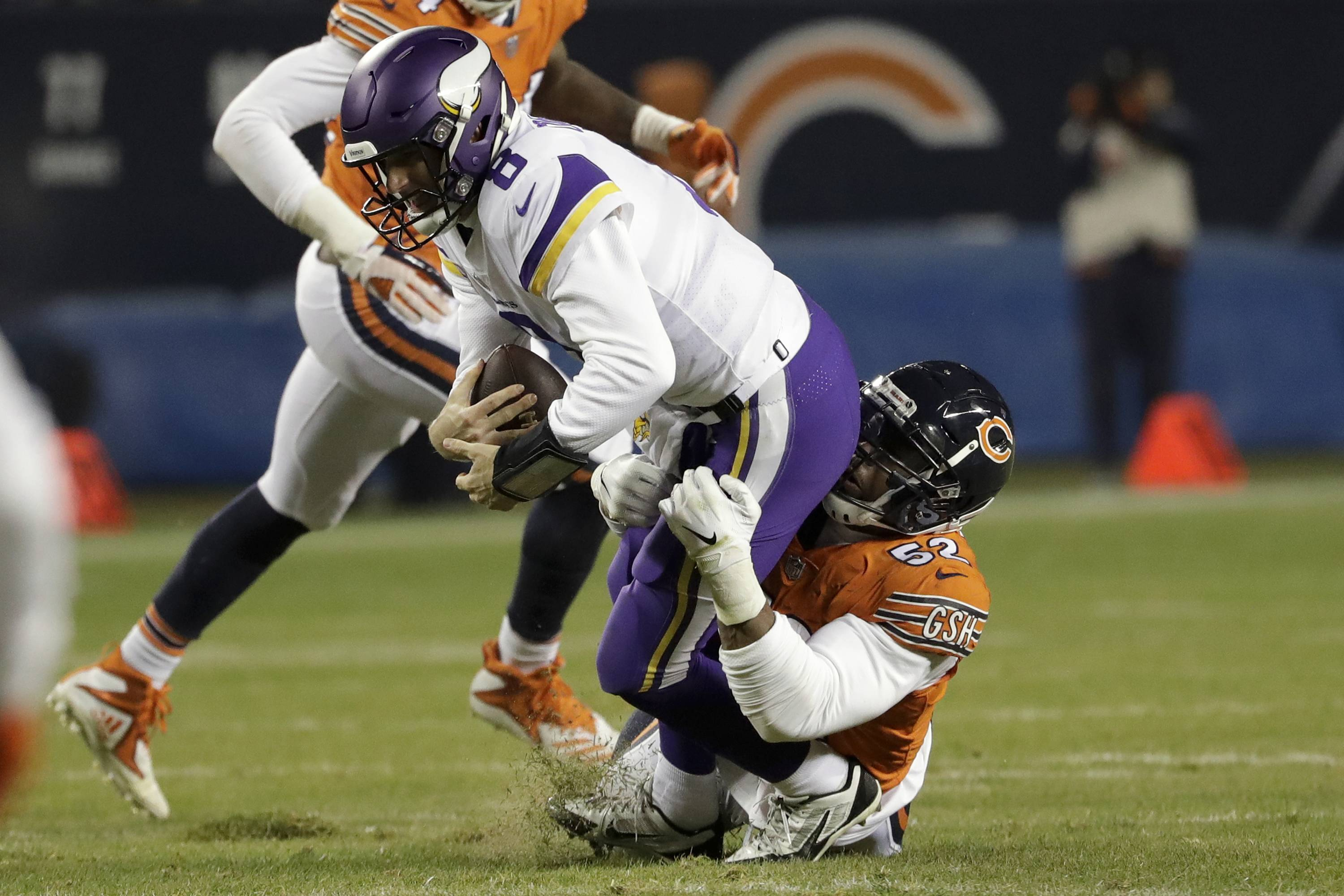 Minnesota Vikings quarterback Kirk Cousins (8) is sacked by Chicago Bears outside linebacker Khalil Mack (52) during the second half of an NFL football game Sunday, Nov. 18, 2018, in Chicago.