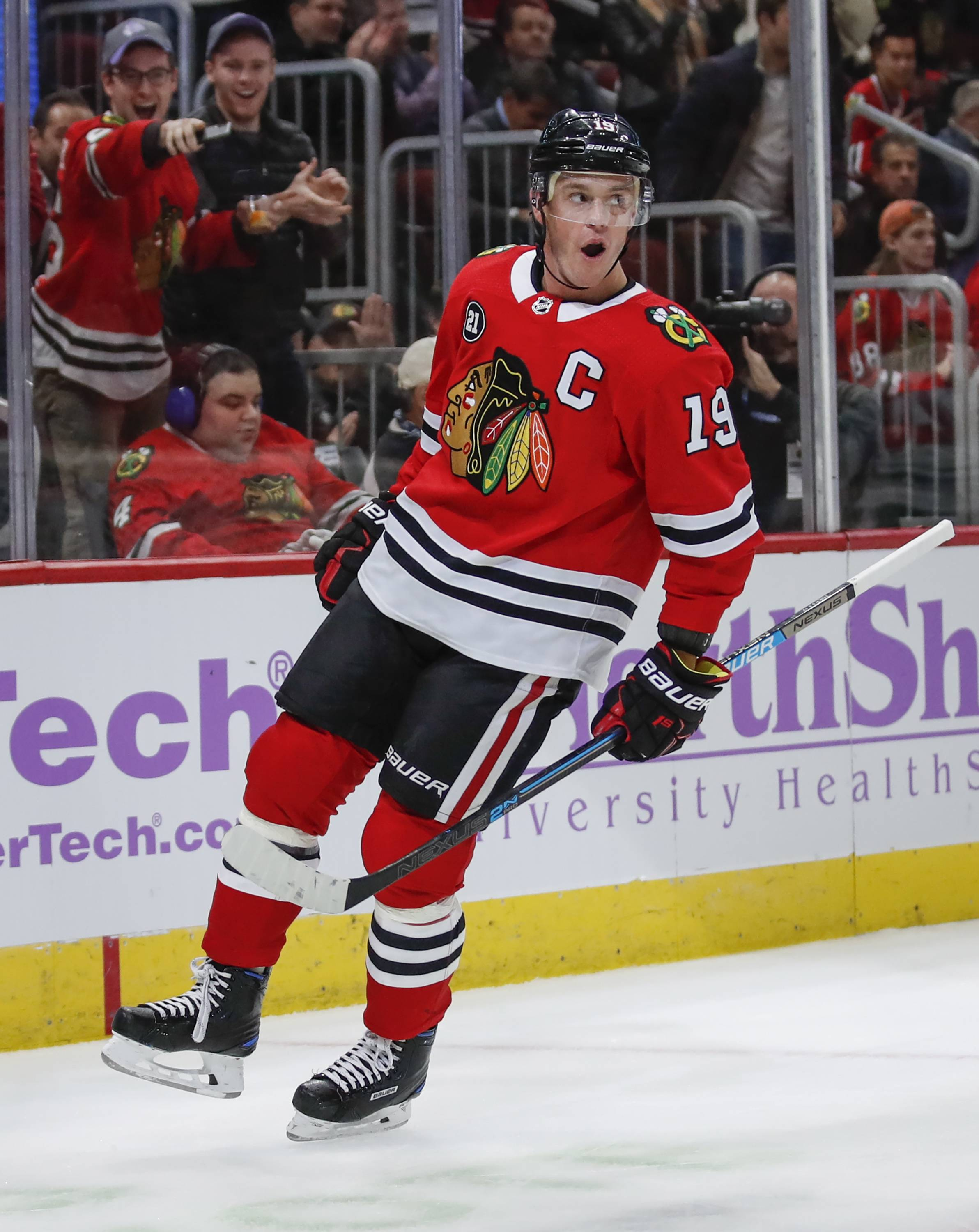 Chicago Blackhawks center Jonathan Toews celebrates after scoring against the Minnesota Wild during the first period of an NHL hockey game Sunday, Nov. 18, 2018, in Chicago.