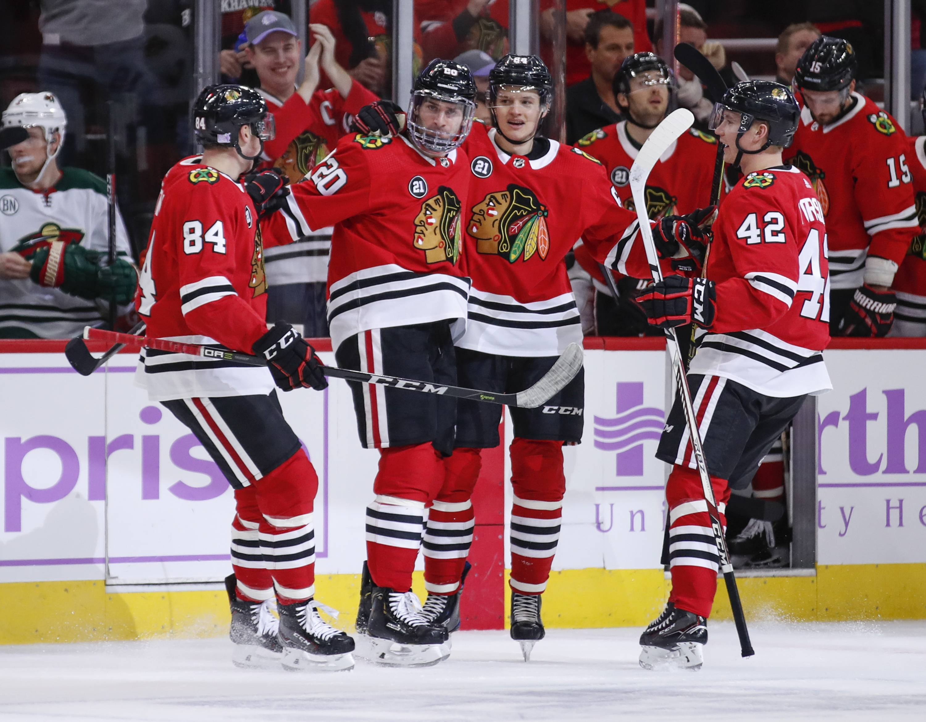 Chicago Blackhawks left wing Brandon Saad (20) celebrates with teammates after scoring against the Minnesota Wild during the first period of an NHL hockey game Sunday, Nov. 18, 2018, in Chicago.