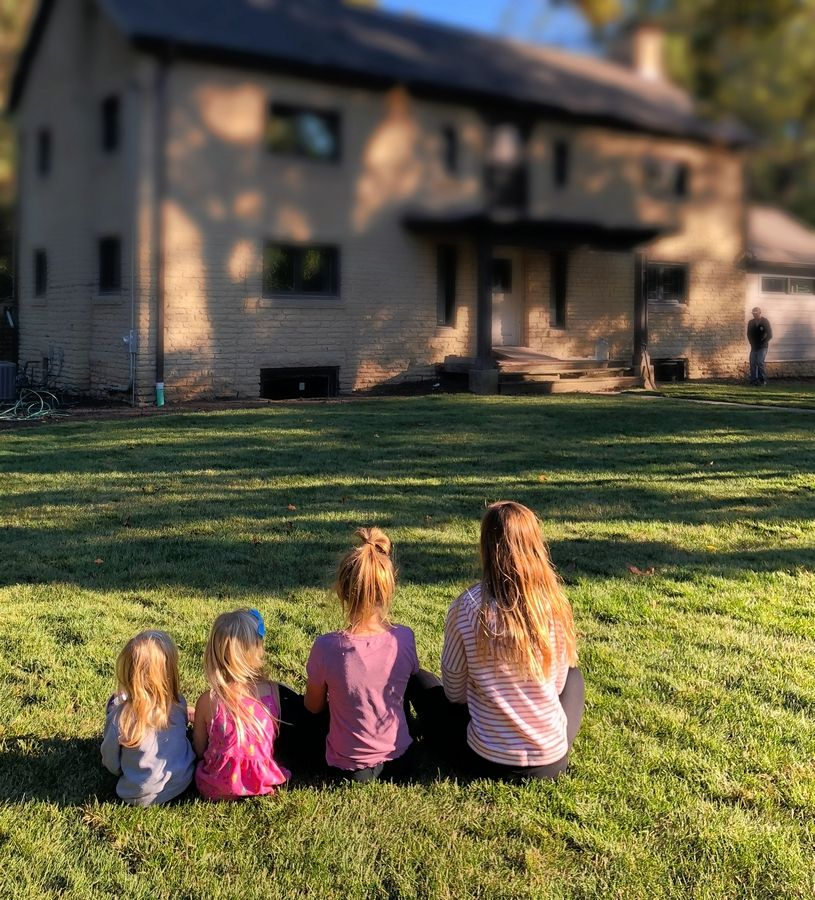 From left, Adam and Angela Emmert's daughters, Cora, 2; Leyna, 3; Ella, 10; and Ashlyn, 11, sit in front of their new home, the Bernard J. Cigrand house at 1184 S. Batavia Ave. Adam Emmert has spent two years renovating and restoring the house, and the family plans to move in before Thanksgiving.