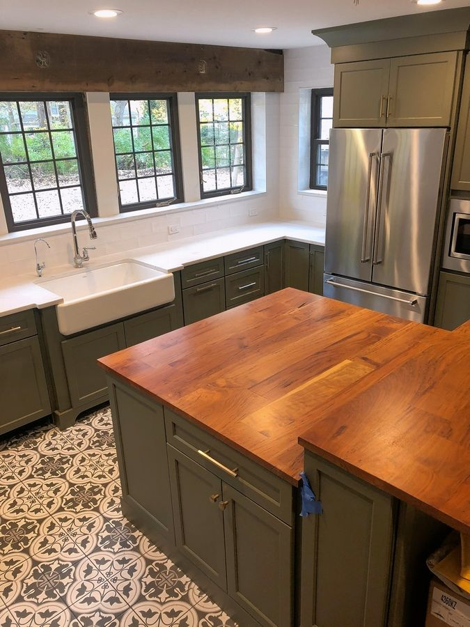 The renovated kitchen of the historic Cigrand house is a special place for Adam Emmert. He has incorporated an island that has a natural wood counter made from a cherry tree that had to be removed from the front yard.