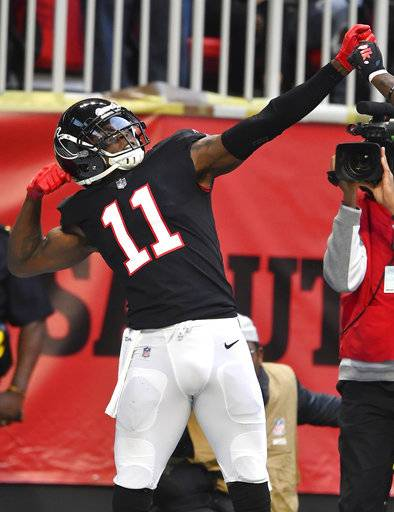 Atlanta Falcons wide receiver Julio Jones (11) celebrates his touchdown catch in the end zone against the Dallas Cowboys during the second half of an NFL football game, Sunday, Nov. 18, 2018, in Atlanta.
