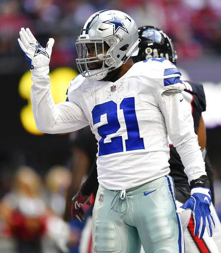 Dallas Cowboys running back Ezekiel Elliott (21) signifies a first down against the Atlanta Falcons during the first half of an NFL football game, Sunday, Nov. 18, 2018, in Atlanta.