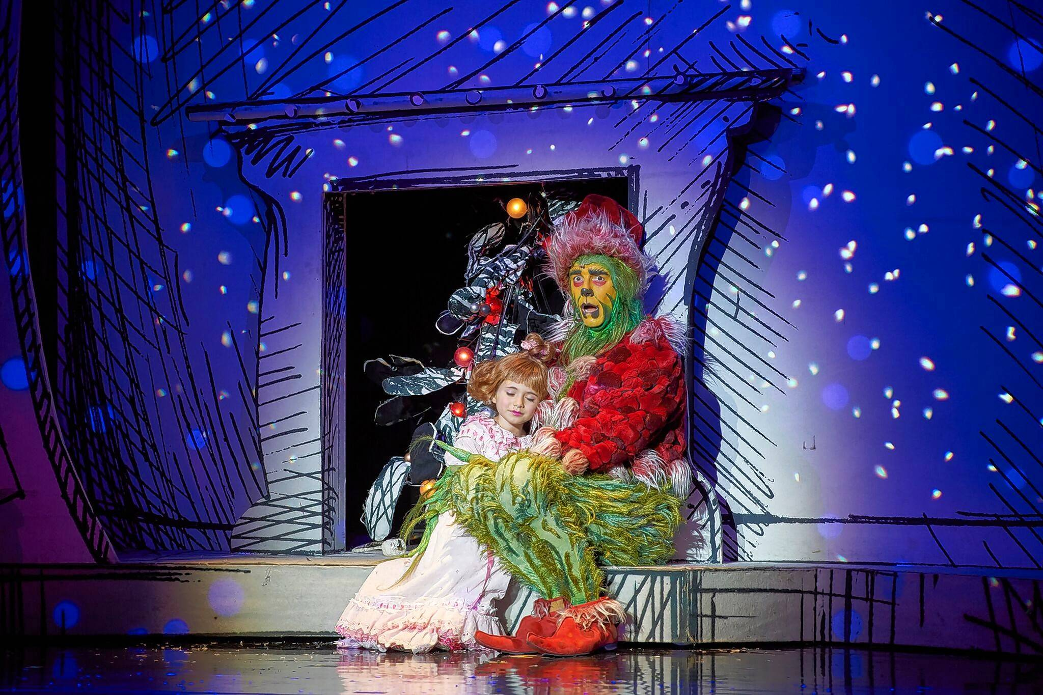 "The Grinch (Gavin Lee) has an epiphany with Cindy Lou Who (Mackenzie Jane Mercer) in ""Dr. Seuss' How the Grinch Stole Christmas! The Musical,"" now playing at the Chicago Theatre."