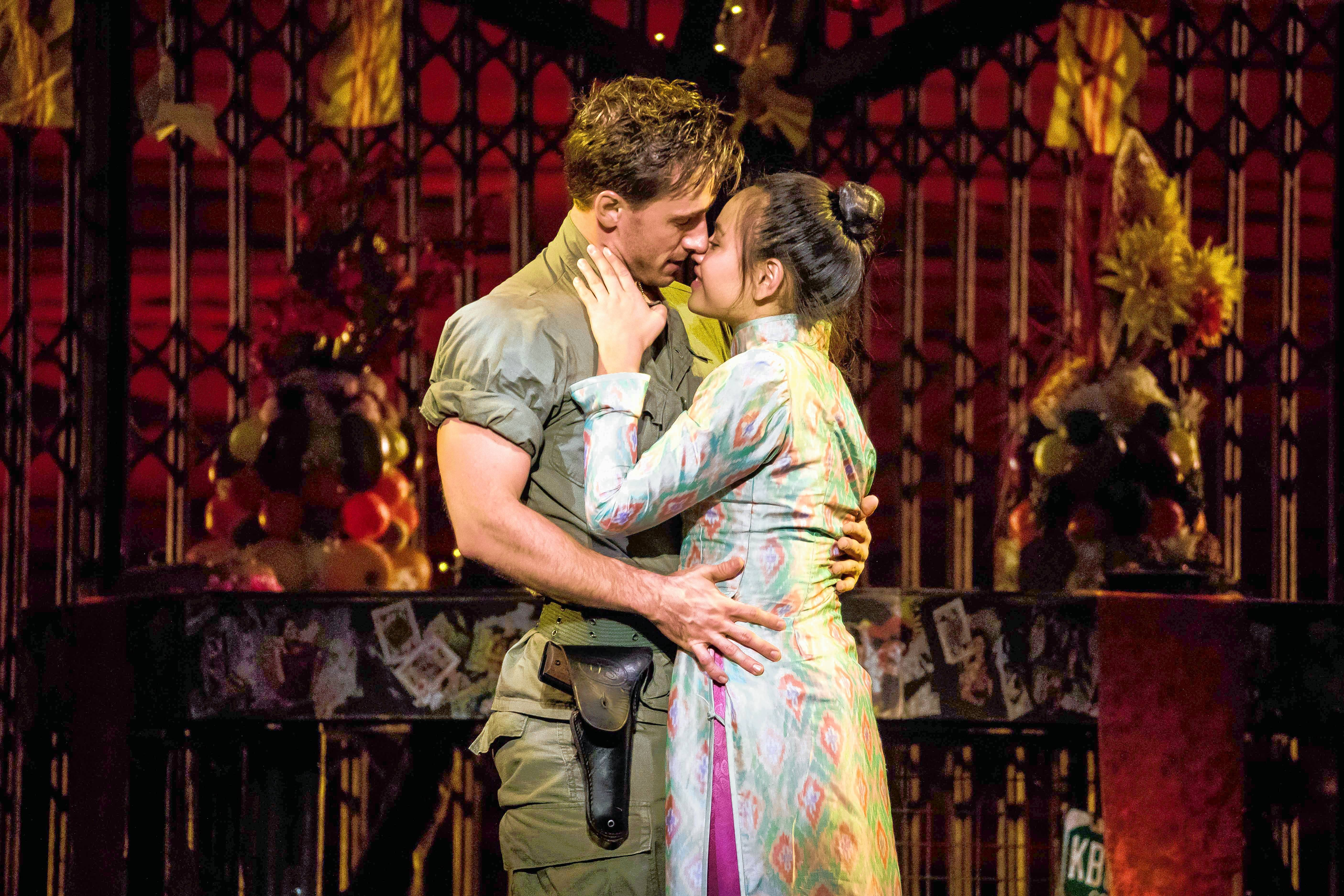 "Kim (Emily Bautista), right, and Chris (Anthony Festa) sing ""Last Night of the World"" in the national tour of ""Miss Saigon"" at the Cadillac Palace Theatre in Chicago."