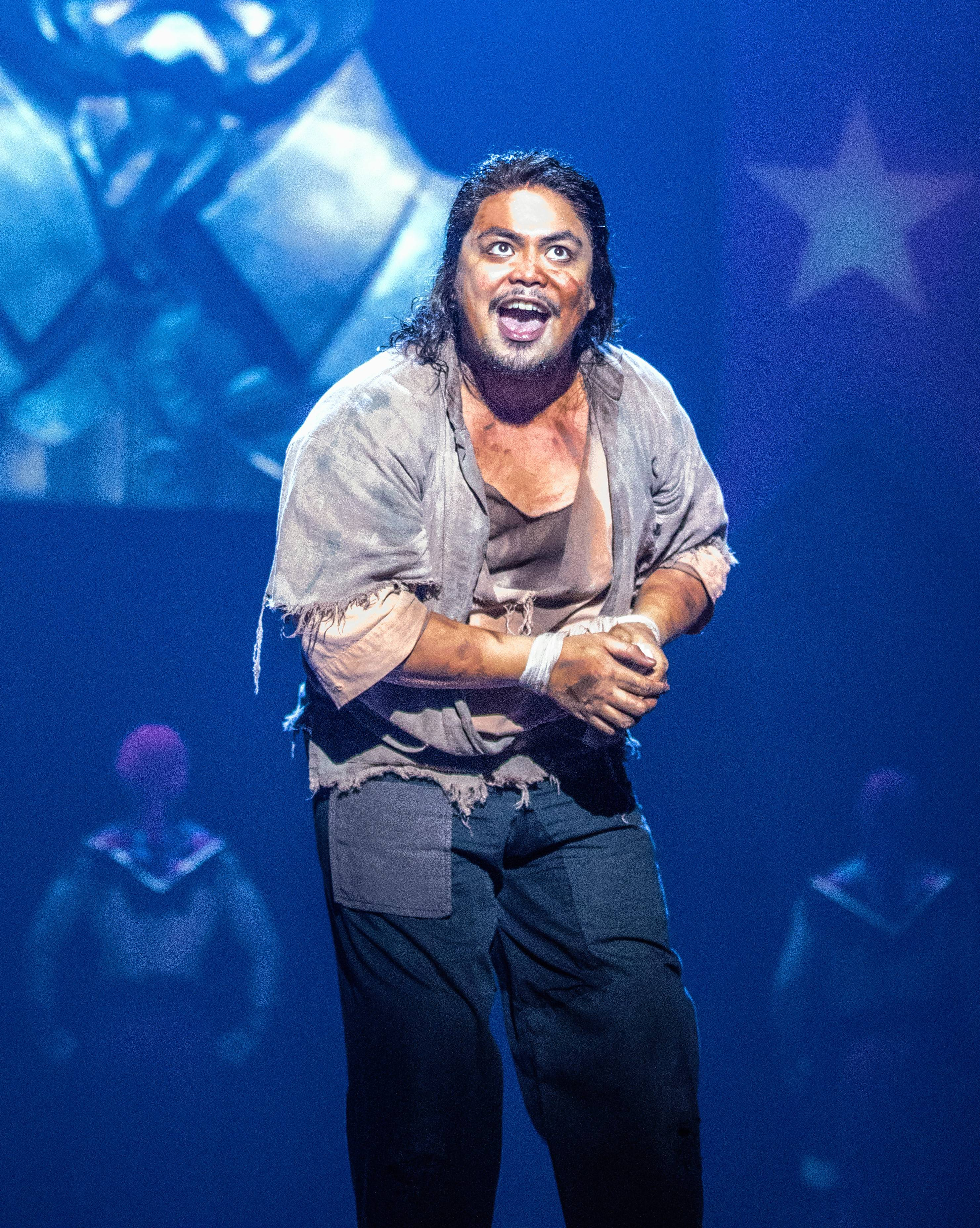 "The Engineer (Red Concepción) sings about enduring ""re-education"" following the fall of Saigon in the national tour of ""Miss Saigon,"" now at the Cadillac Palace Theatre in Chicago through Saturday, Dec. 8."