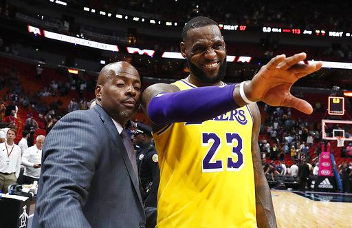 00ba39836 Los Angeles Lakers forward LeBron James waves to a fan after the team s NBA  basketball game
